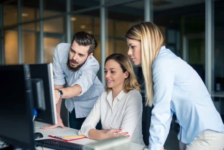 Employee Collaboration Around Computer